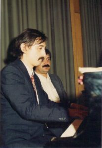 Myron Mytrovych is playing the piano